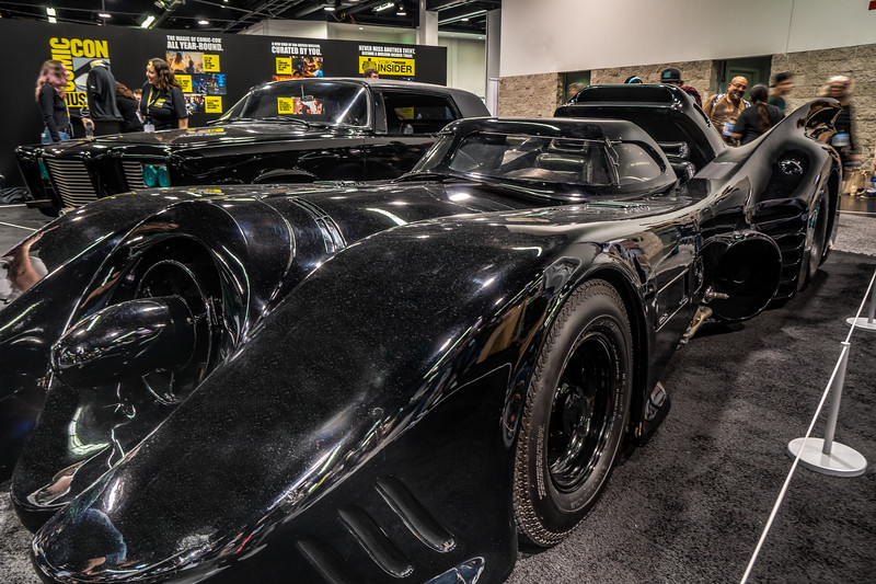 "The batmobile and the Green Hornet's car, ""Black Beauty"", on display at WonderCon"