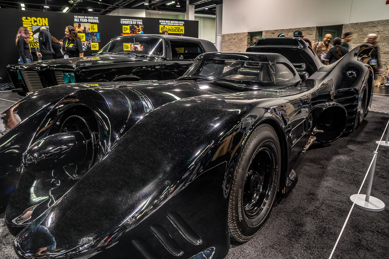 "The batmobile and the Green Hornet's car, ""Black Beauty"", on display at WonderCon 2019"
