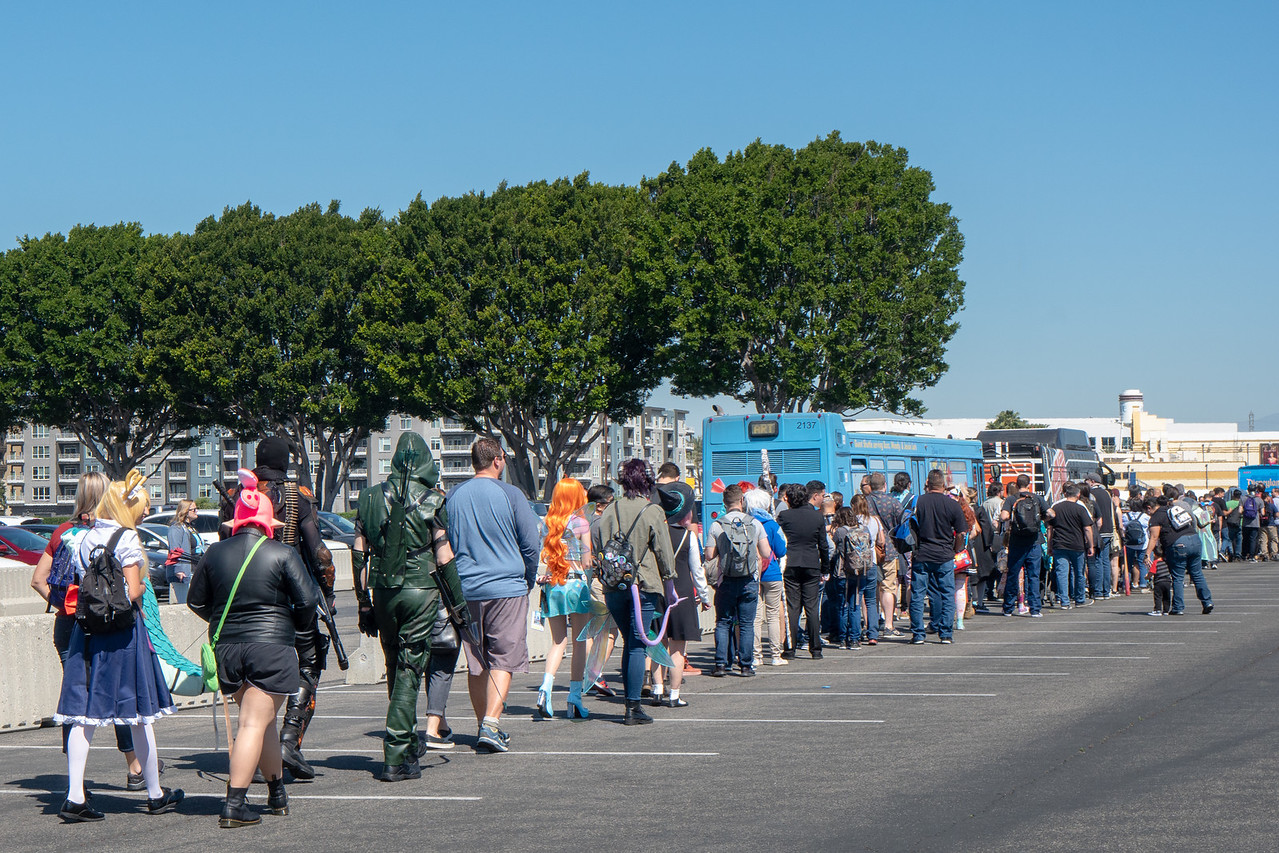 Fans queue for shuttle buses at Angel's Stadium, Anaheim, CA