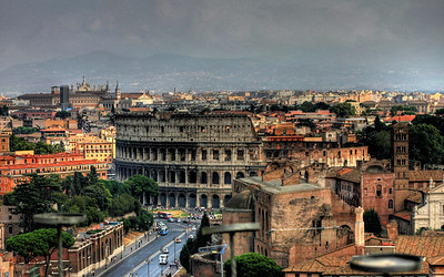 Coliseum and surrounding area viewed from the top of Victor Emmanuel II Monument in Rome Italy.