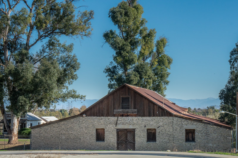 The wine barn, general store and view of the valley to the east of the farm