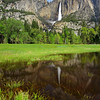 """Yosemite Falls in Spring"" <br>Location: Yosemite National Park, California.  <p></p><p>Spring in Yosemite is beautiful. The waterfalls are at their peak flow, greenary is all around, temperatures are very comfortable and little ponds in the meadows add to the scenary.  </p><p>Tech Info: <br>Lens: Canon EF 17-40mm f/4L @ 23mm <br>Camera: Canon EOS 5D Mk II <br>Exposure: 2sec at f/16 and ISO 50 <br>Filters: Hoya 8 stop solid ND filter to allow 2sec exposure. LEE 0.9 (3-stop) soft edge ND Grad filter to balance exposure of the sky with foreground.  <br><br>Yosemite is the arguably the most beautiful national park. It's grandeur and the time scale it took to evolve is very humbling. I learnt that the granite peaks started out as molten magma deep below the earth's surface about 100 million years ago. Merced river then carved it into a ""V"" shaped valley and finally glaciers shaped it into its present day ""U"" shape. The beauty of the valley has inspired many. It's lush forests, tall granite peaks, amazing monoliths and beautiful waterfalls are so pristine that a visit to the park often overwhelms the senses. A visit here at least once in lifetime is a must.</p>"