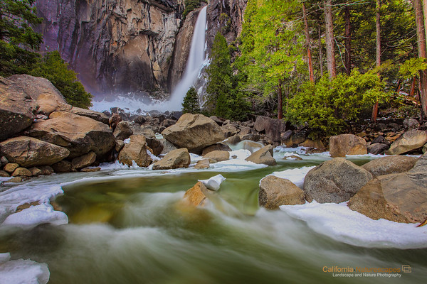 """Lower Yosemite Falls - Spring Flow"" <br>Location: Lower Yosemite Falls, Yosemite National Park, California.  <p></p><p>Spring in Yosemite arrives with a thundering roar of the giant waterfalls. As the snow begins to melt the valley comes back to life.  </p><p>Tech Info: <br>Lens: Canon EF 17-40mm f/4L @ 17mm <br>Camera: Canon EOS 5D Mk II <br>Exposure: 1/6sec at f/16 and ISO 50 <br>Filters: Hoya 4 stop solid ND filter and LEE .6 (2-stop) soft edge graduated neutral density filter </p><p>Post processing: Bringup of details in shadow areas, selective exposure and saturation adjustment, all in Adobe LightRoom 3   <br><br>Yosemite is the arguably the most beautiful national park. It's grandeur and the time scale it took to evolve is very humbling. I learnt that the granite peaks started out as molten magma deep below the earth's surface about 100 million years ago. Merced river then carved it into a ""V"" shaped valley and finally glaciers shaped it into its present day ""U"" shape. The beauty of the valley has inspired many. It's lush forests, tall granite peaks, amazing monoliths and beautiful waterfalls are so pristine that a visit to the park often overwhelms the senses. A visit here at least once in lifetime is a must.</p>"