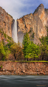 """Evening Light on Bridalveil Falls"" Location: Yosemite National Park, California.  Mid May light of late afternoon falls directly on the walls of Yosemite illuminating them in warm hues.  Tech Info: Lens: Canon EF 70-200 f/4L IS @200mm Camera: Canon EOS 5D Mk II Exposure: 1.3sec at f/16 and ISO 200 Filters: Hoya 8-stop solid ND filter to cut light and allow long exposure This is a stich from five horizontal shots to obtain even exposure during changing lighting conditions.  Yosemite is the arguably the most beautiful national park. It's grandeur and the time scale it took to evolve is very humbling. I learnt that the granite peaks started out as molten magma deep below the earth's surface about 100 million years ago. Merced river then carved it into a ""V"" shaped valley and finally glaciers shaped it into its present day ""U"" shape. The beauty of the valley has inspired many. It's lush forests, tall granite peaks, amazing monoliths and beautiful waterfalls are so pristine that a visit to the park often overwhelms the senses. A visit here at least once in lifetime is a must."
