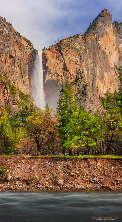 """Evening Light on Bridalveil Falls"" <br>Location: Yosemite National Park, California.  <p>Mid May light of late afternoon falls directly on the walls of Yosemite illuminating them in warm hues.  </p><p>Tech Info: <br>Lens: Canon EF 70-200 f/4L IS @200mm <br>Camera: Canon EOS 5D Mk II <br>Exposure: 1.3sec at f/16 and ISO 200 <br>Filters: Hoya 8-stop solid ND filter to cut light and allow long exposure </p><p>This is a stich from five horizontal shots to obtain even exposure during changing lighting conditions.  <br><br>Yosemite is the arguably the most beautiful national park. It's grandeur and the time scale it took to evolve is very humbling. I learnt that the granite peaks started out as molten magma deep below the earth's surface about 100 million years ago. Merced river then carved it into a ""V"" shaped valley and finally glaciers shaped it into its present day ""U"" shape. The beauty of the valley has inspired many. It's lush forests, tall granite peaks, amazing monoliths and beautiful waterfalls are so pristine that a visit to the park often overwhelms the senses. A visit here at least once in lifetime is a must.</p>"