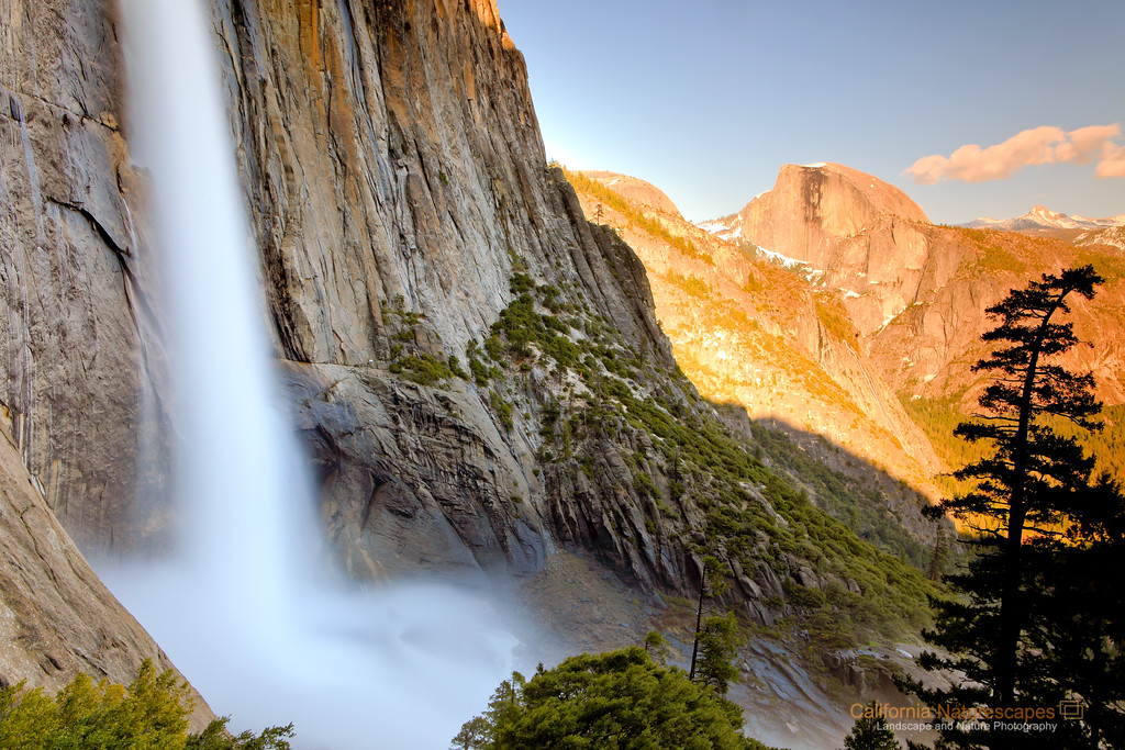 """Upper Yosemite Falls and Half Dome"" <br>Location: Upper Yosemite Falls Trail, Yosemite National Park, California.  <p></p><p>Yosemite falls are so tall that often a direct picture fails to convey that to the viewer. I felt this composition provided more emphasis on the grandeur of these falls especially since the image included view of another Yosemite icon, Half dome.  </p><p>This image was shot half way through the hike on upper Yosemite falls tail. As you start climbing more of the sweeping views of the Yosemite valley can be seen. I hiked all the way up to the top of the falls but realized that the spot from where I shot this image was the best vista point on the entire trail. The view of the falls itself is very captivating but you can also see other prominent features of the valley from here such as iconic Half dome.  </p><p>Tech Info: <br>Lens: Canon EF 24-70mm f/2.8L @ 30mm <br>Camera: Canon EOS 5D Mk II <br>Exposure: 20sec at f/16 and ISO 50 <br>Filters: Hoya 8-stop solid ND filter to cut light and allow long exposure. Two graduated neutral density filters stacked together: LEE 0.9 (3-stop) soft edge and LEE 0.75 hard edge rotated at 2 o'clock position.  <br><br>Yosemite is the arguably the most beautiful national park. It's grandeur and the time scale it took to evolve is very humbling. I learnt that the granite peaks started out as molten magma deep below the earth's surface about 100 million years ago. Merced river then carved it into a ""V"" shaped valley and finally glaciers shaped it into its present day ""U"" shape. The beauty of the valley has inspired many. It's lush forests, tall granite peaks, amazing monoliths and beautiful waterfalls are so pristine that a visit to the park often overwhelms the senses. A visit here at least once in lifetime is a must.</p>"