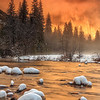 """Magic Hour at Valley View"" <br>Location: Yosemite National Park, California.  <p></p><p>The storm had passed but the fog lingered on El Capitan. As the sunset drew closer the valley was filled with warm glow reflecting off El Cap and merced river.  </p><p>Tech Info: <br>Lens: Canon EF 17-40mm f/4L @ 40mm <br>Camera: Canon EOS 5D Mk II <br>Exposure: 2.5sec at f/18 and ISO 50 <br>Filters: Singh Ray 3 stop rev. ND Grad, LEE .9 soft edge ND Grad and B+W Circular polarizer </p><p>Note: On a day like this make sure to be at this spot an hour or two before sunset. When I arrived here there was still room to find good composition and settle on a spot. Soom many other photographers arrived in frenzy and it was bit of a chaos seeing everyone trying to find a good spot to shoot the drama unfolding at sunset.  <br><br>Yosemite is the arguably the most beautiful national park. It's grandeur and the time scale it took to evolve is very humbling. I learnt that the granite peaks started out as molten magma deep below the earth's surface about 100 million years ago. Merced river then carved it into a ""V"" shaped valley and finally glaciers shaped it into its present day ""U"" shape. The beauty of the valley has inspired many. It's lush forests, tall granite peaks, amazing monoliths and beautiful waterfalls are so pristine that a visit to the park often overwhelms the senses. A visit here at least once in lifetime is a must.</p>"