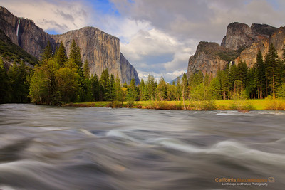 """Valley of Enchantment"" Location: Valley View, Yosemite National Park, California.   Yosemite is arguably the most beautiful national park in the world. I feel very privileged that I stay close to Yosemite and can visit it anytime with a couple of hours drive. The proximity to the park has allowed me to visit it practically in every season. The view captured here is during spring season when the water in the Merced river is high and rapids are in full force. Spring is also the season of waterfalls and you can see that the Bridalveil falls on the right and Ribbontail falls on the left are also flowing at their peak. The waterfalls reach their peak flow due of all the snowmelt at higher elevation.  The beauty in the valley does not end with flows in Merced river and waterfalls alone. The meadows start turning green and bring out a lush green color in the park that is in very good contrast with the warm tones of the granite peaks during evening hours. And when all of this is combined with presence of some clouds in the sky and penetrating light through the pockets in those clouds, you can get very dramatic views in the valley. I happened to catch all of these on the day I shot this image. Though I am very happy with how the image turned out I can't forget that seeing this beauty in person was an altogether different experience. I am glad I could bring back some of that in this image.   Tech Info: Lens: Canon EF 17-40mm f/4L @ 24mm Camera: Canon EOS 5D Mk II Exposure: 1.6sec at f/14 and ISO 100 Filters: Hoya 8-stop solid ND filter along with LEE 0.9 (3-stop) soft edge ND Grad filter  Yosemite is the arguably the most beautiful national park. It's grandeur and the time scale it took to evolve is very humbling. I learnt that the granite peaks started out as molten magma deep below the earth's surface about 100 million years ago. Merced river then carved it into a ""V"" shaped valley and finally glaciers shaped it into its present day ""U"" shape. The beauty of the valley has inspired many. It's lush forests, tall granite peaks, amazing monoliths and beautiful waterfalls are so pristine that a visit to the park often overwhelms the senses. A visit here at least once in lifetime is a must."