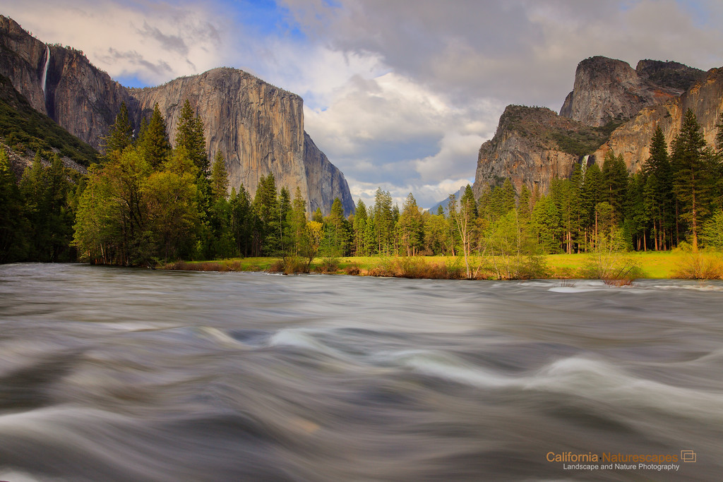 """Valley of Enchantment"" <br>Location: Valley View, Yosemite National Park, California.   <p></p><p>Yosemite is arguably the most beautiful national park in the world. I feel very privileged that I stay close to Yosemite and can visit it anytime with a couple of hours drive. The proximity to the park has allowed me to visit it practically in every season. The view captured here is during spring season when the water in the Merced river is high and rapids are in full force. Spring is also the season of waterfalls and you can see that the Bridalveil falls on the right and Ribbontail falls on the left are also flowing at their peak. The waterfalls reach their peak flow due of all the snowmelt at higher elevation.  </p><p>The beauty in the valley does not end with flows in Merced river and waterfalls alone. The meadows start turning green and bring out a lush green color in the park that is in very good contrast with the warm tones of the granite peaks during evening hours. And when all of this is combined with presence of some clouds in the sky and penetrating light through the pockets in those clouds, you can get very dramatic views in the valley. I happened to catch all of these on the day I shot this image. Though I am very happy with how the image turned out I can't forget that seeing this beauty in person was an altogether different experience. I am glad I could bring back some of that in this image.   </p><p>Tech Info: <br>Lens: Canon EF 17-40mm f/4L @ 24mm <br>Camera: Canon EOS 5D Mk II <br>Exposure: 1.6sec at f/14 and ISO 100 <br>Filters: Hoya 8-stop solid ND filter along with LEE 0.9 (3-stop) soft edge ND Grad filter  <br><br>Yosemite is the arguably the most beautiful national park. It's grandeur and the time scale it took to evolve is very humbling. I learnt that the granite peaks started out as molten magma deep below the earth's surface about 100 million years ago. Merced river then carved it into a ""V"" shaped valley and finally glaciers shaped it into its present day ""U"" shape. The beauty of the valley has inspired many. It's lush forests, tall granite peaks, amazing monoliths and beautiful waterfalls are so pristine that a visit to the park often overwhelms the senses. A visit here at least once in lifetime is a must.</p>"