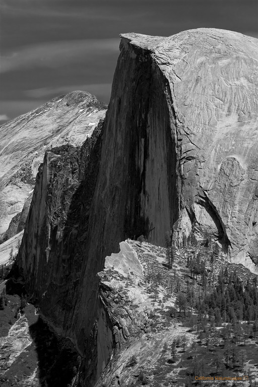 """Half Dome"" Location: Glacier Point, Yosemite National Park, California.  Glacier Point has the best vantage point for Half Done in my opinion. Well, of course, there is nothing that compares to actually hiking up the Half Dome, but it's grandeur is impressive no matter from where you look at it.  It is such an iconic rock that it is a symbol of Yosemite National Park. The solid monolith was sheared in half by the massive glaciers that once filled the valley, hence the name Half Dome.  Tech Info and Tip: Lens: Canon EF 70-200 f/4L IS @127mm Camera: Canon EOS 30D Exposure: 1/320sec at f/4 and ISO 100 <br><br>Yosemite is the arguably the most beautiful national park. It's grandeur and the time scale it took to evolve is very humbling. I learnt that the granite peaks started out as molten magma deep below the earth's surface about 100 million years ago. Merced river then carved it into a ""V"" shaped valley and finally glaciers shaped it into its present day ""U"" shape. The beauty of the valley has inspired many. It's lush forests, tall granite peaks, amazing monoliths and beautiful waterfalls are so pristine that a visit to the park often overwhelms the senses. A visit here at least once in lifetime is a must."