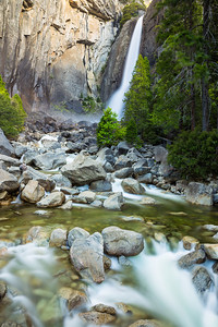 I arrived here before sunrise. This is lower yosemite falls. I also took a moonbow shot for this falls at midnight a day before. Check it out here http://shikha.smugmug.com/Portfolio/yosemite-spring2013/29502717_V6gj5q#!i=2549859626&k=CCMKTbz