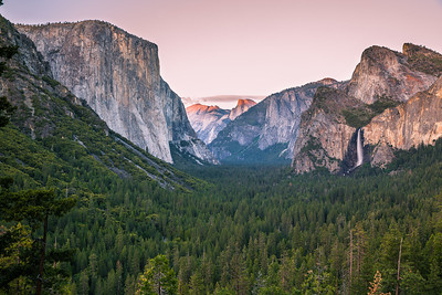 Granite cliffs, El Capitan, Half Dome and bridal veil falls at sunset. The last rays on half dome. This wasn't a spectacular day for sunset. Not much action in the sky. Still this sight is always pleasing to eyes.