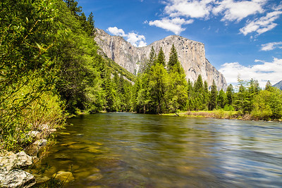 May 12 - El Capitan ,a vertical granite monolith at Yosemite NP. I set my tripod on rocks at the shore, partially submerged in the water . This allowed me to capture the merced river flow that complemented the cloud patterns and the granite monolith very well. You can see ribbon falls only during this time of the year. In a few weeks, it will dry up.