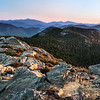 I took this shot just after the sun had come up on top of Mt. Chocoura in the White Mountains.  I had hiked up in the dark - starting out from UNH at 11:45 p.m. the night before - and started hiking up the mountain itself at 1:20 in the morning.  I made great time on the way up and was freezing on top of the mountain for almost a whole hour before the sun finally came up and revealed the beautiful view of the surrounding white mountains!  This shot here is looking back down the trail that goes up the bare face of Chocorua - if you have never been it is an awesome hike!