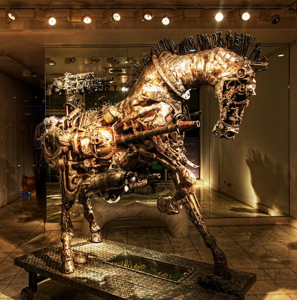 """The Steampunk Horse I was in London and found this place just after my wife and I had a lovely dinner with Matt Ridley (have you seen his TED Talk on """"When Ideas Have Sex""""?)  Visit my Best TED Talks page to see it... right there at the top! He's a great guy and his TED speech did not mention why ideas would come together to make a steampunk horse.  We passed a gallery in a nice part of town that was totally dark and mysterious -- except for this wonderful creation inside.  I could not resist and had to whip out the tripod to make it happen!- Trey RatcliffClick here to read the rest of this post at the Stuck in Customs blog."""