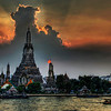 "<h2>One Night in Bangkok</h2> <br/>I arrived into Thailand this weekend and have been in content-creation mode non stop.  I did take a chance back at the hotel to process this one picture I thought y'all would enjoy.<br/><br/>(and yes that sun picture is real... it was burning through the bottom while still streaming light over the top).<br/><br/>This picture is of Wat Arun, a famous Buddhist temple in Thailand.  I took it from a really cool little Italian restaurant across the way that is attached to a boutique hotel named ""Arun Residence"".  I will stay at this place next time - be sure to get the balcony room at the top if you come... it's just over $100 a night and is the best (and only) view of this temple in Bangkok.<br/><br/>- Trey Ratcliff<br/><br/><a href=""http://www.stuckincustoms.com/2006/11/19/one-night-in-bangkok/"" rel=""nofollow"">Click here to read the rest of this post at the Stuck in Customs blog.</a>"