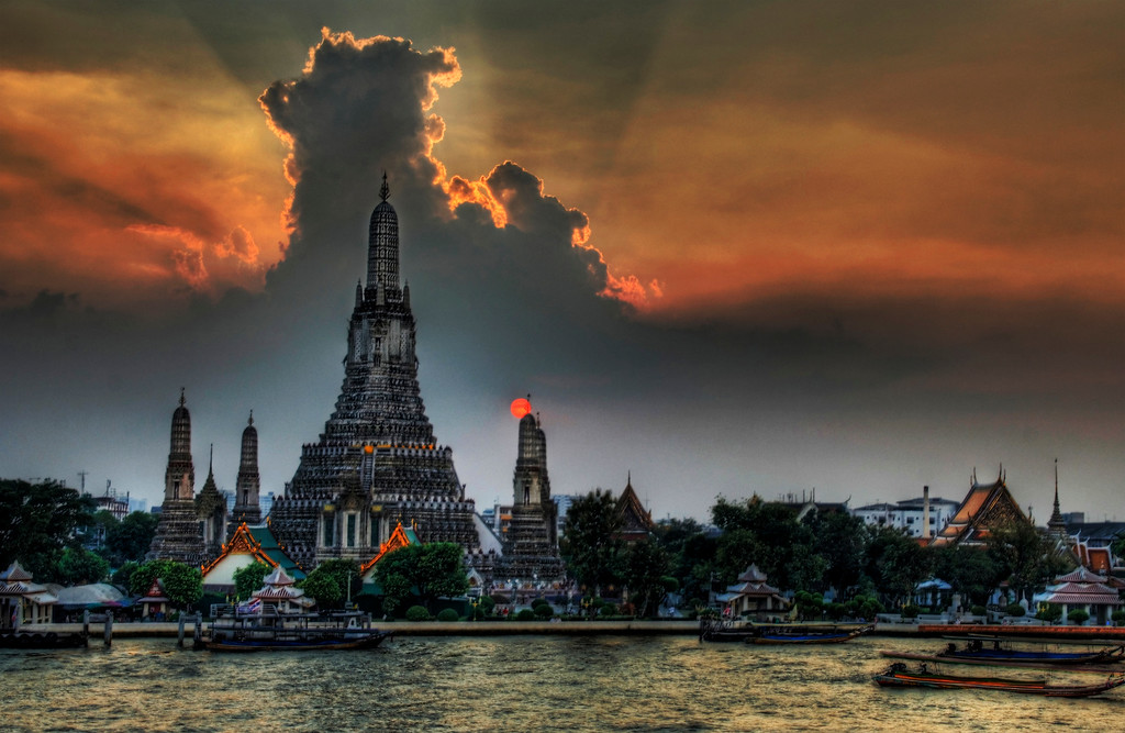 """One Night in Bangkok I arrived into Thailand this weekend and have been in content-creation mode non stop.  I did take a chance back at the hotel to process this one picture I thought y'all would enjoy.(and yes that sun picture is real... it was burning through the bottom while still streaming light over the top).This picture is of Wat Arun, a famous Buddhist temple in Thailand.  I took it from a really cool little Italian restaurant across the way that is attached to a boutique hotel named """"Arun Residence"""".  I will stay at this place next time - be sure to get the balcony room at the top if you come... it's just over $100 a night and is the best (and only) view of this temple in Bangkok.- Trey RatcliffClick here to read the rest of this post at the Stuck in Customs blog."""