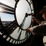 Glen Garrett manually adjusts the disconnected west face of the clock to the time on his watch while chatting with Timothy Hu and watching workers from the Tower Clock Company perform maintenance on the Depot Clock Tower Friday, September 13, 2019 in downtown Cheyenne. Nadav Soroker/Wyoming Tribune Eagle