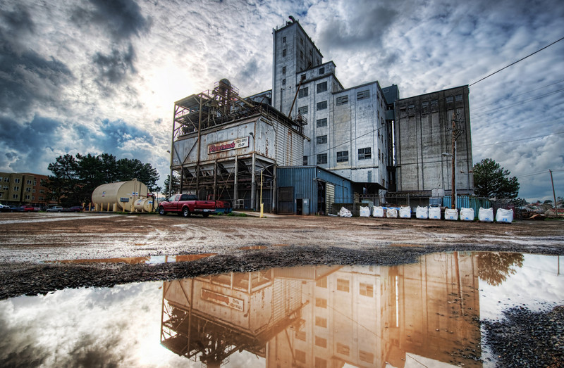 "<h2>Heavy Industry in Petaluma</h2> <br/>Taking photos near ground-water can be very interesting.  And hard!  Getting near that puddle is tough because you have to splay out the tripod.  Even worse, you gotta kneel down in the muck (since puddles usually involve nearby muck).  But, these are all relatively high-grade problems, all in all ... <br/><br/> - Trey Ratcliff <br/><br/>The rest of this entry can be read <a href=""http://www.stuckincustoms.com/2010/07/16/heavy-industry-in-petaluma/"">here</a> at stuckincustoms.com."