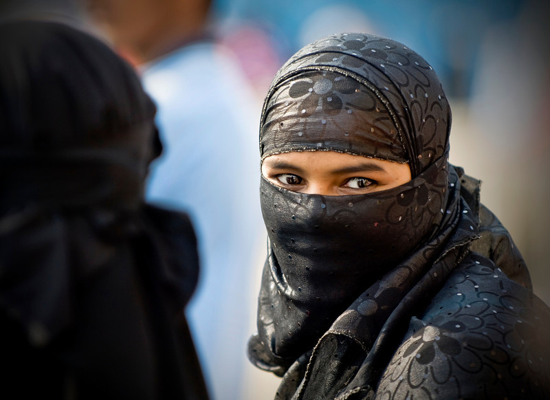 "<h2>This is Secret</h2> <br/>I found her walking with her hooded ilk around the back streets of Mumbai.  Usually when I see a cadre of the enshrouded, they are accompanied by Muslim man that is glaring at almost everyone.  This time there seemed to be no alpha around, so I asked her for her name.  She looked at me and smiled (I think) and then looked furtively around to see if anyone was watching.  I got the distinct impression that since I was a white oddity that actually spoke to her that she wanted to talk, but then thought better of it and made a slight bow before gliding away.<br/><br/>- Trey Ratcliff<br/><br/><a href=""http://www.stuckincustoms.com/2007/11/18/this-is-secret/"" rel=""nofollow"">Click here to read the rest of this post at the Stuck in Customs blog.</a>"