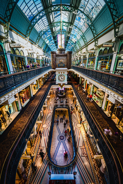 Shopping in the Queen Victoria Building Whenever anyone (non-photographers) sees me with my tripod in a shopping mall, they assume I must be on some kind of a commercial assignment! I guess there is still a general association of big equipment to commercial photography by those outside of our sport.See that castle in the middle? Every so often, there is a little automated puppet show that delights the crowd. Everyone crowds around the rails to watch the event.- Trey RatcliffClick here to read the rest of this post at the Stuck in Customs blog.