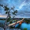 """<h2>The Pennybacker Bridge</h2> <br/>This place is right by my house…. I really have no excuse for not going up here almost every night! It takes less than 10 minutes to drive and hike up here… sometimes I actually feel bad about my laziness in this area.<br/><br/>It's usually not too crowded up here. Maybe a couple or two will sit and watch the sunset. It's a bit dangerous – a sharp cliff that drops off into the freeway on one side and the water on the other.<br/><br/>- Trey Ratcliff<br/><br/><a href=""""http://www.stuckincustoms.com/2011/12/02/the-pennybacker-bridge/"""" rel=""""nofollow"""">Click here to read the rest of this post at the Stuck in Customs blog.</a>"""