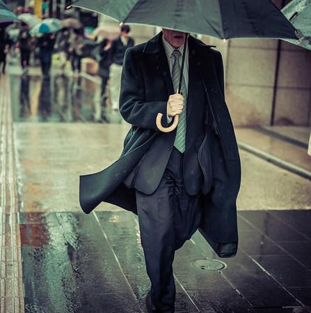 Man With Umbrella In Tokyo Rain