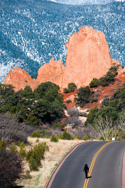 A woman walks the middle of the road into Garden of the Gods during the Motorless Morning on Saturday, April 21, 2018. Cars were blocked from entering the park from 5 a.m. to 10 a.m.<br /> <br /> (Nadav Soroker, The Gazette)