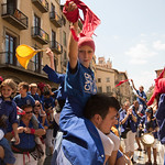 Young Castellers dance around on the shoulders of their older relatives after the end of the tower building in Vic, Catalonia on the last day of a festival.