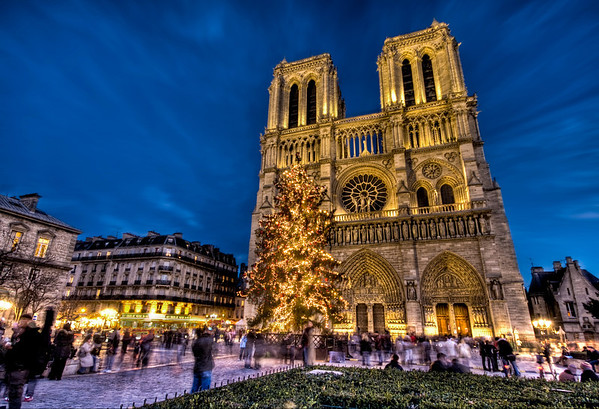 Merry Christmas from Notre Dame Don't miss the giant Christmas tree in front!I tried my best to sneak inside and go up top with the gargoyles, but the guards at Notre Dame are tough to trick... REAL tough!- Trey RatcliffClick here to read the rest of this post at the Stuck in Customs blog.