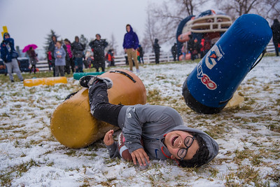 Diego Hernandez, 10, slides to the ground after hitting a tackle dummy during the Denver Broncos' 'Salute to Fans Rally' on Saturday, April 21, 2018 at the Budweiser Brewery Experience in Fort Collins.