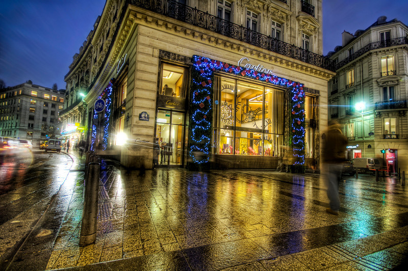Cartier on the Champs-Élysées at Christmas I was working on this photo this evening with a friend to show him some of the techniques that have evolved since HDR started getting popular. I find my methodology changes and evolves about every two months or so. I look back at my old stuff in horror!Ah yes… the wet streets of Paris here… Seems like an idyllic place for this little store called Cartier, eh?- Trey RatcliffClick here to read the rest of this post at the Stuck in Customs blog.