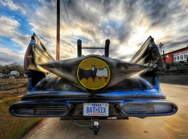 The Batmobile Everyone likes the Batmobile yes?  It's especially cool when you see one on the side of the road in Texas that some comic-book redneck has souped up to be something that is on the edge of street-legal.  I jumped out quick to grab a shot before the owner could come out and hit me with some sort of a 2x4, which I only assumed me might be carrying.  Actually, you never know... around Austin it's just as likely to be a doctor or lawyer (assuming one of those two to be an honorable, upstanding profession!(also notice the nice only-in-Texas trailer hitch on the back)- Trey RatcliffClick here to read the rest of this post at the Stuck in Customs blog.