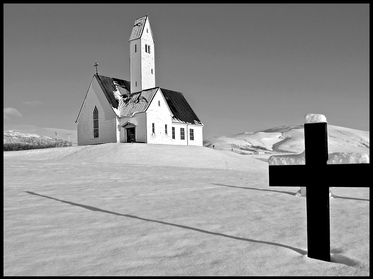 Icelandic Cemetery with a church in the background