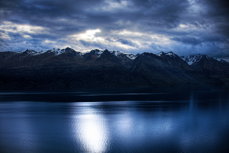"""<h2>The Range at Night</h2> <br/>I drove to Glenorchy (a not-bustling suburb of Queenstown) late in the afternoon.  After doing a bit of shooting and snacking, I took a perfect little road back to Queenstown.  It runs along a long and perfect lake.  The sun had dropped to an interesting spot, and I could see the heavens were boiling away... so I pulled over to take this quick shot.<br/><br/>- Trey Ratcliff<br/><br/><a href=""""http://www.stuckincustoms.com/2010/12/07/interview-in-queenstown-part-1/"""" rel=""""nofollow"""">Click here to read the rest of this post at the Stuck in Customs blog.</a>"""