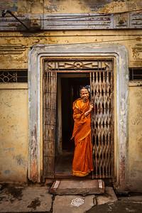 TIRUCHIRAPPALLI, INDIA - FEBRUARY 15, 2013: Unidentified India woman standing in the doorway of her house