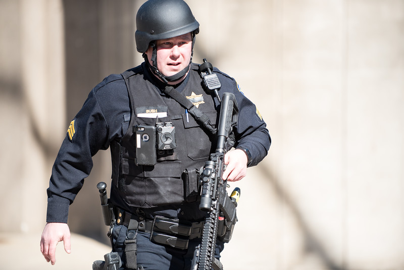 An armed Evanston police officer runs while on the scene of what turned out to be a hoax active shooter call on March 14, 2018. | Colin Boyle/The Daily Northwestern