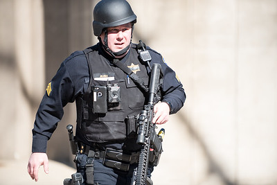 March 14, 2018 – An armed Evanston police officer runs while on the scene of what turned out to be a hoax active shooter call