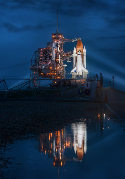 "<h2>Final Night of the Space Shuttle</h2> <br/>I was completely soaked after laying in mosquito-invested waters for an uncomfortably long time. At one point, a concerned French news reporter came up to me and said, ""Excuse me, but you're quite covered in bugs."" It must have been pretty bad for him to come over and say that... I think perhaps he thought I was dead because I stayed in the same position for so long, trying to zen-focus on the shot.  This is the Space Shuttle Atlantis, in case you do not know. It's also the final space shuttle launch, ever. So, it's incredibly special, and I'm happy I got to spend time with the ship on its final night.<br/><br/>- Trey Ratcliff<br/><br/>Read more <a href=""http://www.stuckincustoms.com/2011/07/08/final-night-of-the-space-shuttle/"">here</a> at the Stuck in Customs blog."