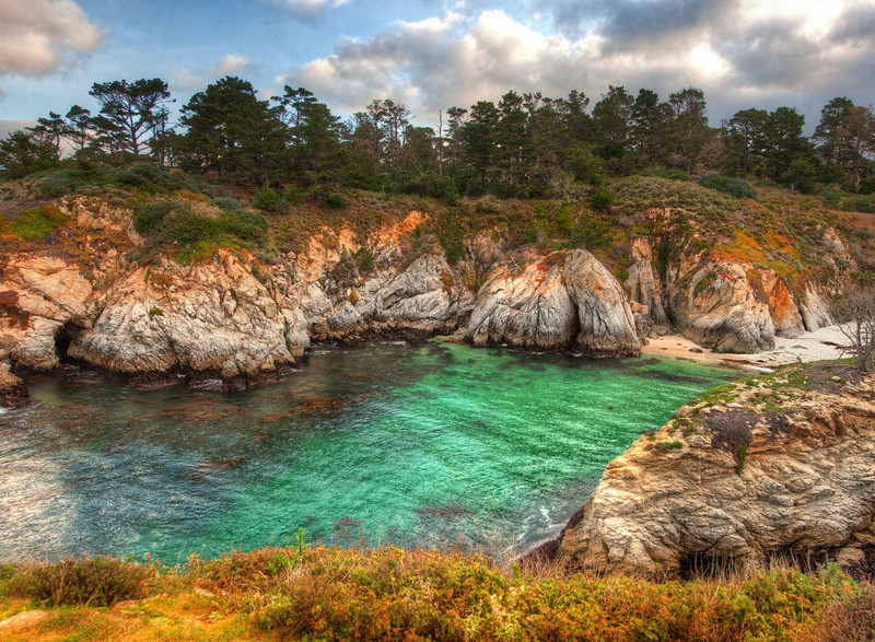 """<h2>Hiking in Carmel</h2> Just south of Carmel-by-the-Sea is a hiking trail that goes along the coast.  I went down at sunrise one morning to see what I could find.  The entrance to the trail was blocked by a gate, and there was no ranger in the little box-place where rangers stand.  I was bamboozled.  There was no way through or around.  I could have walked, but it looked like the road went on quite a ways before the parking lot.<br/><br/>So I waited until some other guy came along to let himself in.  I was parked a ways back, and so I got his attention from afar by grunting and raising my Nikon-on-tripod over my head like a sand raider -- he got the message and waved me through.<br/><br/>- Trey Ratcliff<br/><br/><a href=""""http://www.stuckincustoms.com/2012/06/01/hiking-in-carmel/"""" rel=""""nofollow"""">Read the entire post at the Stuck in Customs blog.</a>"""