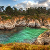 "<h2>Hiking in Carmel</h2> Just south of Carmel-by-the-Sea is a hiking trail that goes along the coast.  I went down at sunrise one morning to see what I could find.  The entrance to the trail was blocked by a gate, and there was no ranger in the little box-place where rangers stand.  I was bamboozled.  There was no way through or around.  I could have walked, but it looked like the road went on quite a ways before the parking lot.<br/><br/>So I waited until some other guy came along to let himself in.  I was parked a ways back, and so I got his attention from afar by grunting and raising my Nikon-on-tripod over my head like a sand raider -- he got the message and waved me through.<br/><br/>- Trey Ratcliff<br/><br/><a href=""http://www.stuckincustoms.com/2012/06/01/hiking-in-carmel/"" rel=""nofollow"">Read the entire post at the Stuck in Customs blog.</a>"
