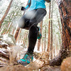Athlete and trail runner Megan Lund, trains after a fresh morning of snow in Boulder Colorado on a spring morning.