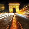 """<h2>Arc de Triomphe</h2> <br/>This is a dangerous spot!  But so pretty...<br/><br/>It was a cool night in Paris.  It was a bit damp too, as if it might rain at any moment.  So that kept me moving from spot to spot pretty quickly.  I was secretly hoping for a bit of rain... Europe at night in a light rain is always kind of charming.  I'm pretty sure that locals don't find it charming... just annoying.<br/><br/>- Trey Ratcliff<br/><br/><a href=""""http://www.stuckincustoms.com/2010/12/12/arc-de-triomphe/"""" rel=""""nofollow"""">Click here to read the rest of this post at the Stuck in Customs blog.</a>"""