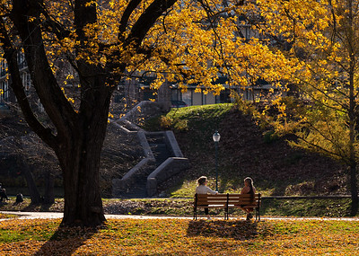Two women taking a rest after an afternoon walk in Congress Park, Saratoga Springs NY. 11-10-2020