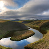 """<h2>The Gentle Oxbow</h2> <br/>Do perfect little places like this really exist? <br/><br/>Yes! <br/><br/>But they are a little hard to find… They're not in guidebooks or written about on [most] travel photography websites. In fact, they're all over the place. This was taken in an area of southern Iceland, on the road not too far from Hvolsvollur and Vik. If you just turn off the main road and meander down a few dirt paths, places like this are everywhere.<br/><br/>One of the most unusual places about this, which is missing from the photograph, are the bird sounds. They were extremely unusual, high-pitched, and made small siren-sounds when diving to and fro. The strange-nature sounds made me feel even more like I was on some strange Star Trek away mission.<br/><br/>- Trey Ratcliff<br/><br/><a href=""""http://www.stuckincustoms.com/2010/11/21/the-gentle-oxbow/"""" rel=""""nofollow"""">Click here to read the rest of this post at the Stuck in Customs blog.</a>"""