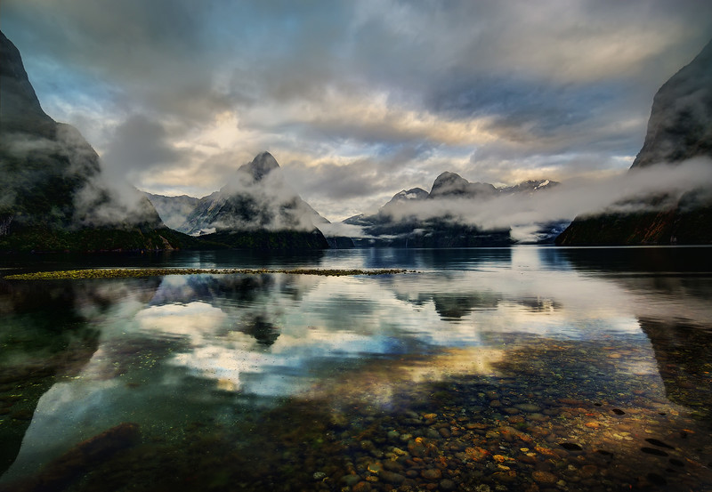 "<h2>The Ghostly Spirits in Milford Sound</h2> <br/>We had a lucky morning in Milford Sound! In retrospect, it was really dumb to bring so many people to Milford when the weather could have been horrible! But man, we really lucked out! I would say there is good weather there (shootable weather) only 50% of the time.<br/><br/>There are many favorite little things about this photo. One of them is that little greenish island out into the bay… that has a good feeling to it, I think. <br/><br/>- Trey Ratcliff<br/><br/><a href=""http://www.stuckincustoms.com/2013/05/06/new-hdr-tutorial-free-web-version-with-new-videos/"" rel=""nofollow"">Click here to read the rest of this post at the Stuck in Customs blog.</a>"