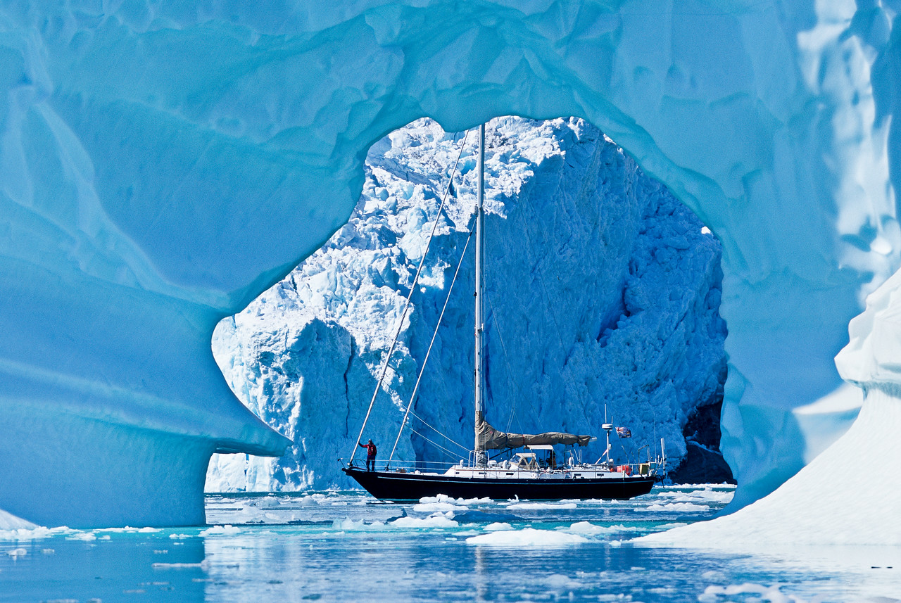 Sailboat with arch ice berg