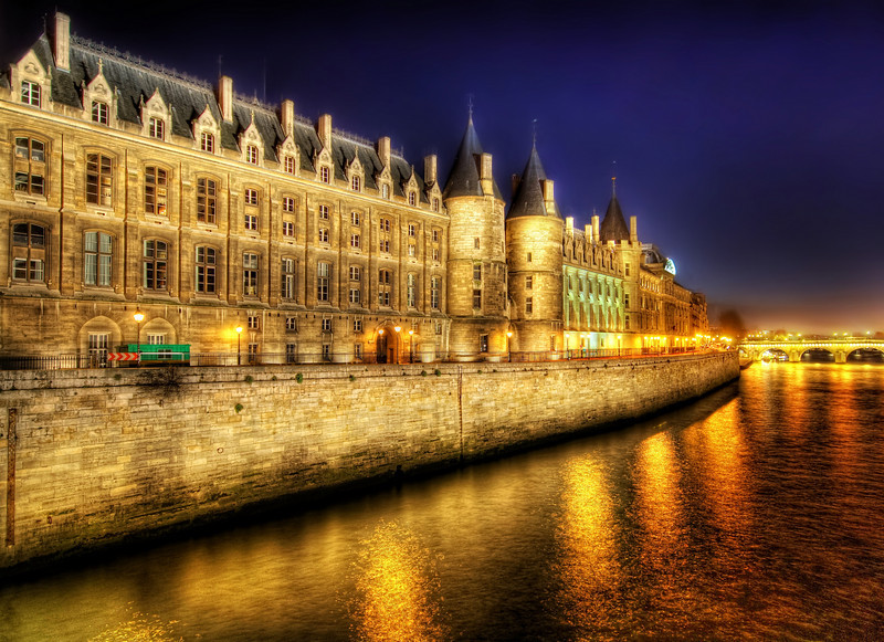 """<h2>The Castle that Never Ends</h2> <br/>These Parisian facades along the Seine are about as classically European as it gets. When these buildings are lit up at night, they are really beautiful in their orange hues.  I took this after leaving Notre Dame and walking across a bridge heading north. I took so many photos of scenic spots… I could hardly figure out what to process first! I actually lament not being here at sunset, but the deep dusky blue still worked out pretty good.<br/><br/>- Trey Ratcliff<br/><br/><a href=""""http://www.stuckincustoms.com/2009/07/31/the-castle-that-never-ends/"""" rel=""""nofollow"""">Click here to read the rest of this post at the Stuck in Customs blog.</a>"""