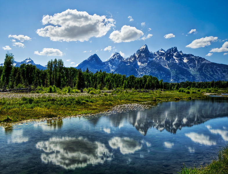 """<h2>The Grand Tetons</h2> <br/>We drove down to the south of Yellowstone near Jackson Hole to explore the Grand Tetons. Just as I was taking this picture, a huge bison came up behind me and caught me unawares… and I barely got the fifth exposure to this HDR! It's amazing how big those things are and they are still quiet.<br/><br/>- Trey Ratcliff<br/><br/><a href=""""http://www.stuckincustoms.com/2007/06/24/the-grand-tetons/"""" rel=""""nofollow"""">Click here to read the rest of this post at the Stuck in Customs blog.</a>"""