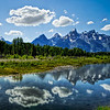 "<h2>The Grand Tetons</h2> <br/>We drove down to the south of Yellowstone near Jackson Hole to explore the Grand Tetons. Just as I was taking this picture, a huge bison came up behind me and caught me unawares… and I barely got the fifth exposure to this HDR! It's amazing how big those things are and they are still quiet.<br/><br/>- Trey Ratcliff<br/><br/><a href=""http://www.stuckincustoms.com/2007/06/24/the-grand-tetons/"" rel=""nofollow"">Click here to read the rest of this post at the Stuck in Customs blog.</a>"